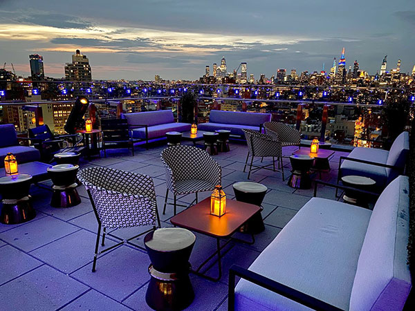 https://www.americanway.com/public/uploads/NYC-Bars-The-Crown-at-50-Bowery-courtesy.jpg