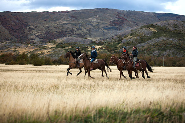 https://www.americanway.com/public/uploads/PL-Best-Sporting-Resorts-Explora-Patagonia-Hotel-Horseback-Ride-courtesy.jpg
